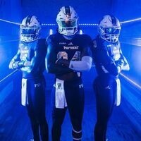 Three Football Players in blue lighting
