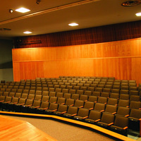 photo of the interior of Marsh Auditorium taken from the stage looking out over the audience chairs