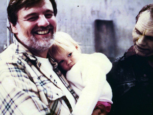 George A. Romero holding daughter, Tina, with Day of the Dead zombie, Bub.