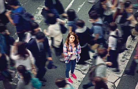 Young woman highlighted in a picture of a crowd.