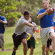 This picture has 5 people in it playing flag football.