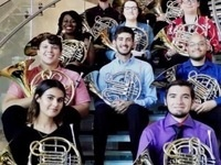 USM School of Music Horn Students posing with their horn instruments