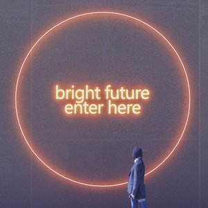 young person looking at a neon sign that says bright future enter here