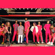 Mwenso and the Shakes band members  on stage all wearing hot pink