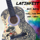 intricately painted acoustic guitar with rainbow colored background and a city building silhouette