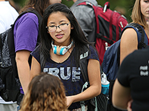 Student at a club table at the Activities Fair