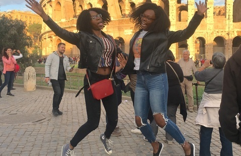 Two students jumping for joy in Rome, Italy