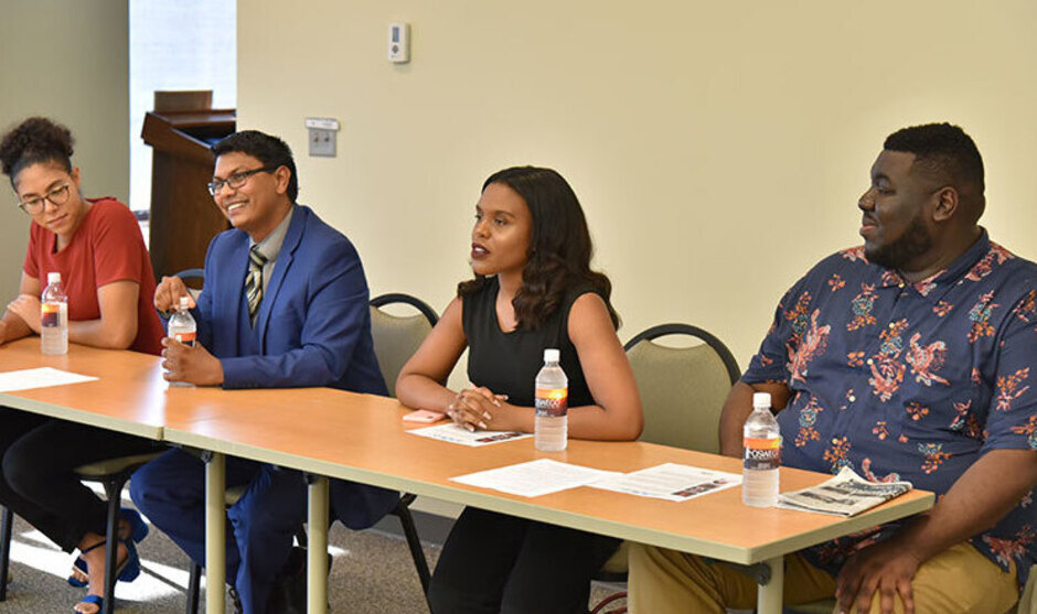 Four students on a panel.