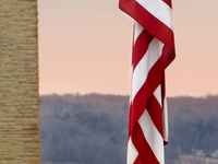 Cornell Clock Tower and American Flag at half-staff