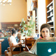 2 students in the library using laptops