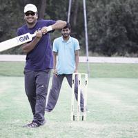 Players playing box cricket
