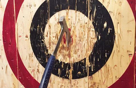 Axe stuck in a wooden wall target