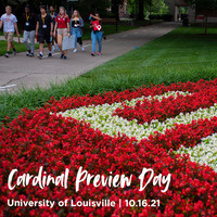 """A group of visitors walk through UofL's green, park-like Belknap Campus on a student-led tour. The words """"Cardinal Preview Day, University of Louisville, 10.16.21"""" overlay the photograph."""