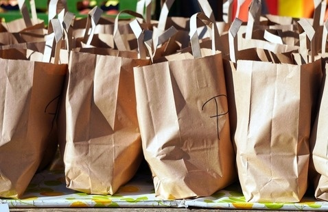 many paper bags sitting on a table