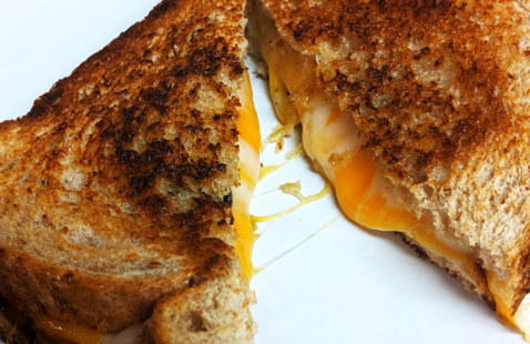 Melted cheese in a grilled cheese sandwich