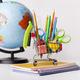 Photo of a globe, pencils, and scissors