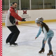 Instructor and student learning to skate
