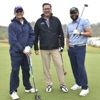 Three golfers with clubs