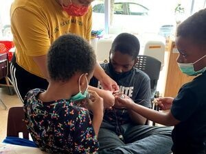 Browne Fellow working with kids