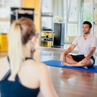 two people on yoga mat breathing