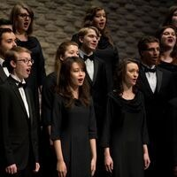 Members of Simpson College's choirs, dressed in formal concert blacks, perform in Smith Chapel.