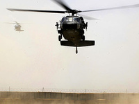 A UH-60 Black Hawk helicopter lands at a forward operating base in Afghanistan, June 6, 2011.