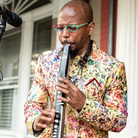 photo by EVERGIB/Brian Gibson; image is of Victor Haskins playing an EWI
