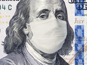 one hundred dollar bill with a mask on.
