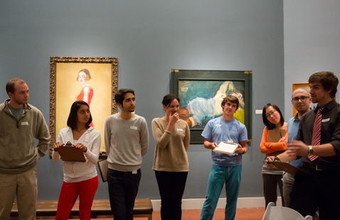 Image of group in gallery in discussion