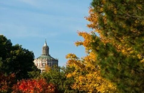 The University of Rochester library emerges among fall foliage.
