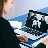 student meeting virtually with 3 other faculty members