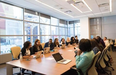 A group of people sitting around a conference table