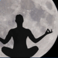 silhouette of a person sitting, meditating with the full moon in the background