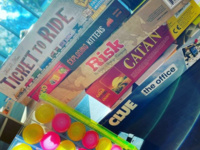 Some of Munday Library's board games stacked by the window.