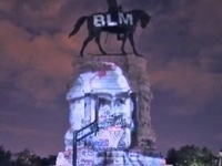 BLM projection of Malcolm X on Lee Memorial, Richmond, VA.