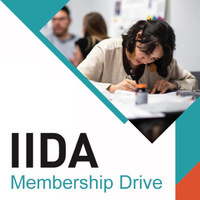 Student focusing on project at desk with text IIDA Membership Drive