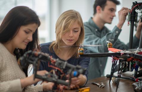 Engineering students working on robotics