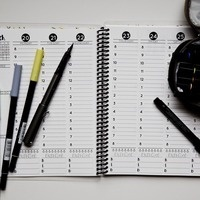 a weekly planner and pens