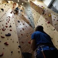 two people at climbing wall