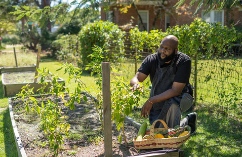 Keith Alexander, LTSS café chef, tends to the new community garden on Columbia's campus.