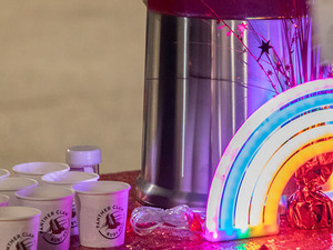 Neon rainbow light and small paper cups.
