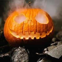 Carved pumpkin with smoke coming out of its eyes