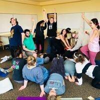Students doing fun yoga