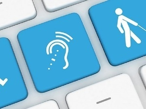 keyboard with blue keys featuring icons of a wheelchair, an ear with simulated sound, and someone using a white cane