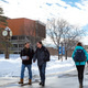 Students on the snow-covered academic quad.