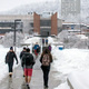 Students walk toward the Campus Center in winter.