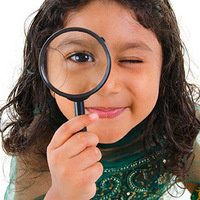 searching girl with magnifying glass