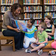 story time, librarian and children