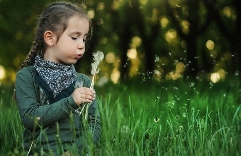 child outside in grass