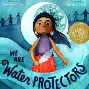 """Book cover of """"We are water protectors"""" features indigenous child with feather in hand surrounded by waves."""